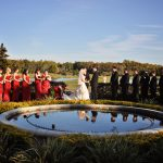 Couple being married outside behing pond at Rosen Shingle Creek