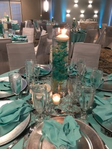 Wedding Reception Table with Green napkins and glassware