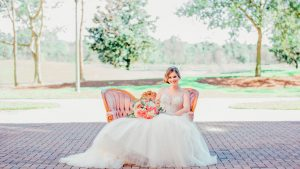 Bride Sitting On Couch with Flowers
