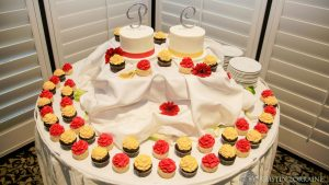 Red/Yellow Froseted Cupcakes and Cake on Table