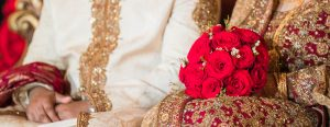 Indian bride holding flowers