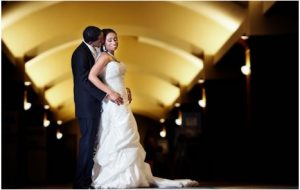 Groom Holding Bride in Hallway for Photoshoot