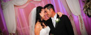 Asian bride and groom face to face smiling