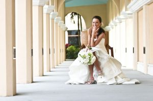 Bride Sitting Down Posing with Flowers