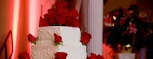 White cake with red roses