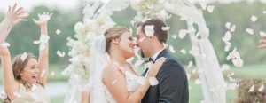Newlyweds Surrouned by Flowers Thrown from Wedding Party