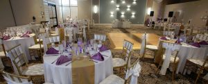 White, purple, and gold table setup