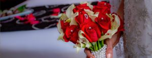 Brides Boquet with Red and White Flowers Wrapped in Pearls
