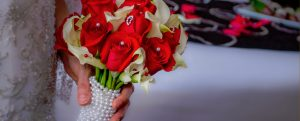 Red and White flowers wrapped in pearls