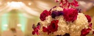 White, red, purple, and pink flowers in vase