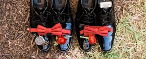 Grooms Shoes with watch, rings, amd bow tie on top
