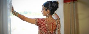 Bride in Tradition Indian Wedding Dress Looking out Window