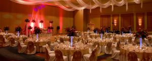 Wedding Reception with White Table cloths and flower center pieces