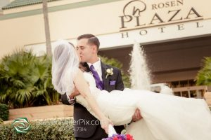 Newlyweds Kissing in front of Rosen Plaza