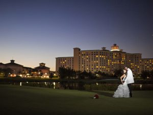 Wedding Couple at Night in front of Rosen Shingle Creek