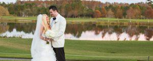 Newlyweds outside infront of lake at Rosen Shingle Creek