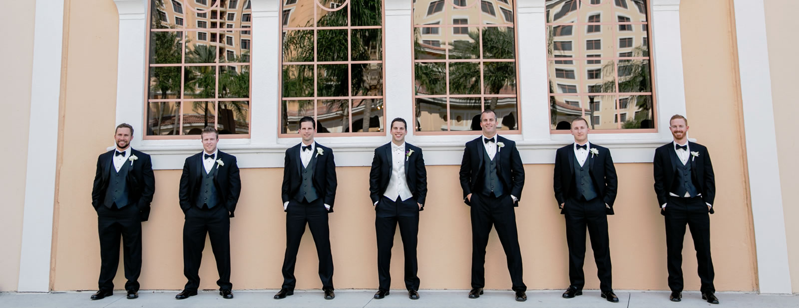 Grooms standing in line outside Rosen Shingle Creek